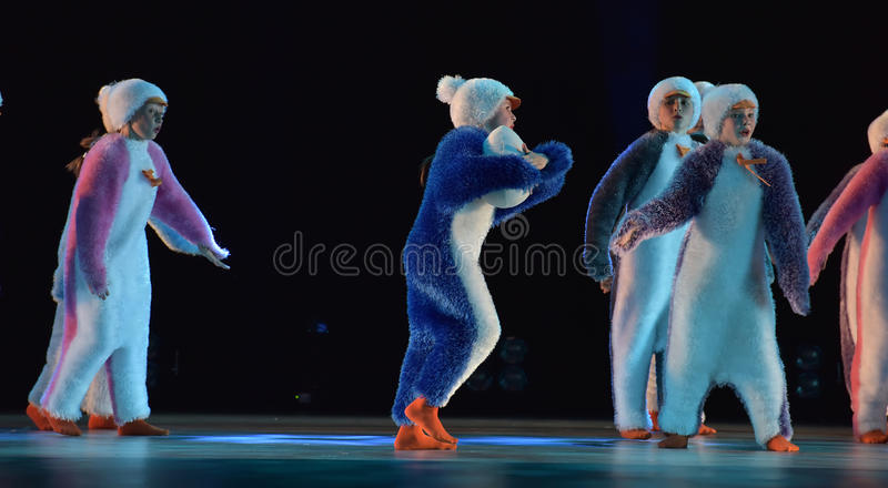Children in a suit of penguins dance on a stage, Children`s danc. E group, Petersburg, Russia stock photos