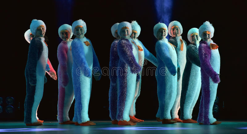 Children in a suit of penguins dance on a stage, Children`s danc. E group, Petersburg, Russia stock images
