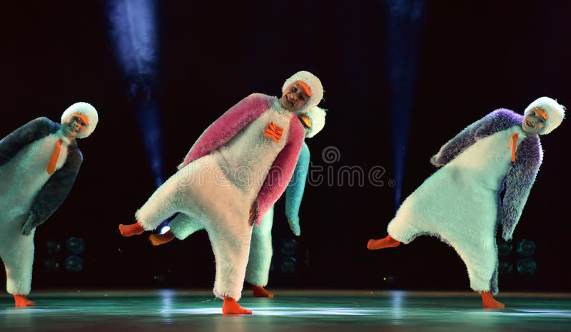 Children in a suit of penguins dance on a stage, Children`s danc. E group, Petersburg, Russia stock image