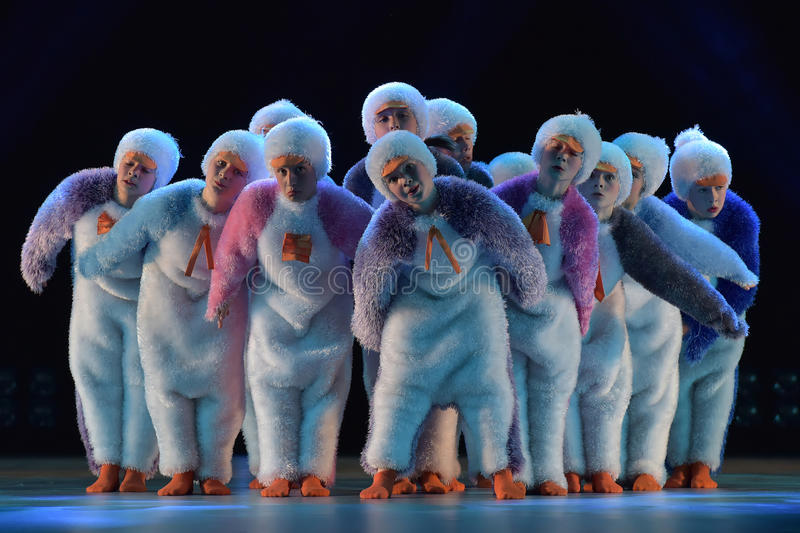 Children in a suit of penguins dance on a stage, Children`s danc. E group, Petersburg, Russia royalty free stock images