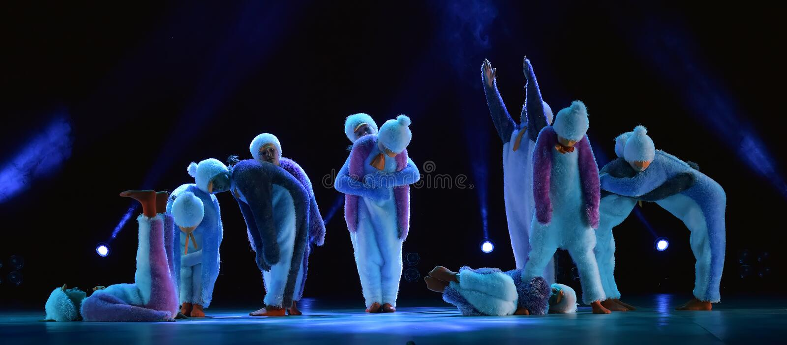 Children in a suit of penguins dance on a stage, Children`s danc. E group, Petersburg, Russia royalty free stock photography