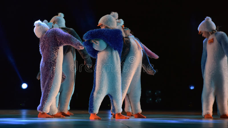 Children in a suit of penguins dance on a stage, Children`s danc. E group, Petersburg, Russia stock photography
