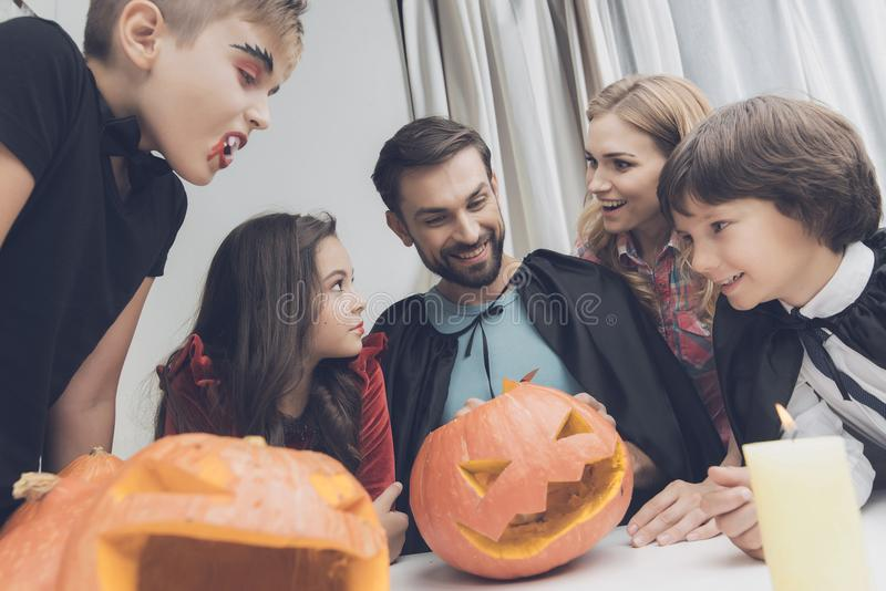 The family looks at the beautiful pumpkin that my father cut out for a Halloween party royalty free stock image