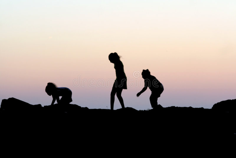 Children Sunset Silhouette stock images