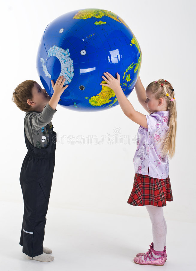 Children supporting the globe royalty free stock images