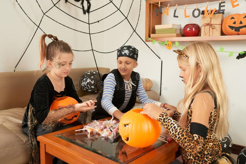 Children with sweets at Halloween party royalty free stock images