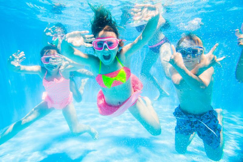 Children swim in  pool royalty free stock photography
