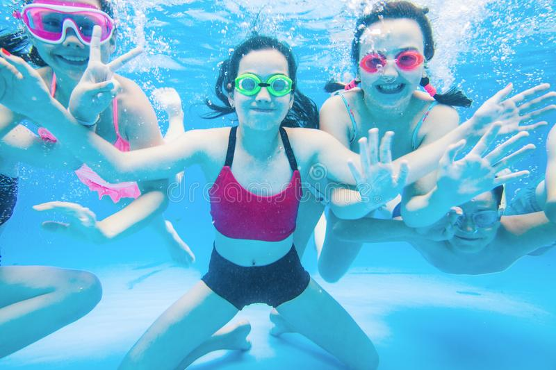 Children swim in  pool stock photos