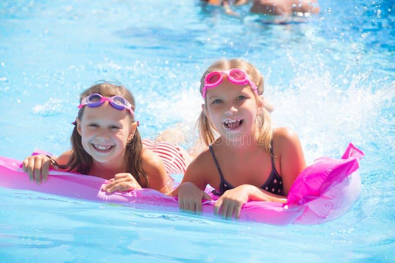 Children swim in  pool stock images