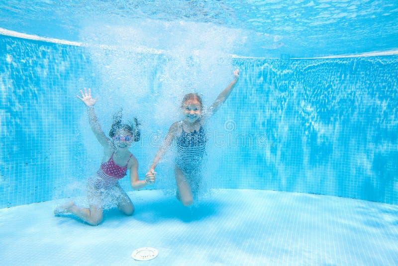 Children swim in  pool stock image