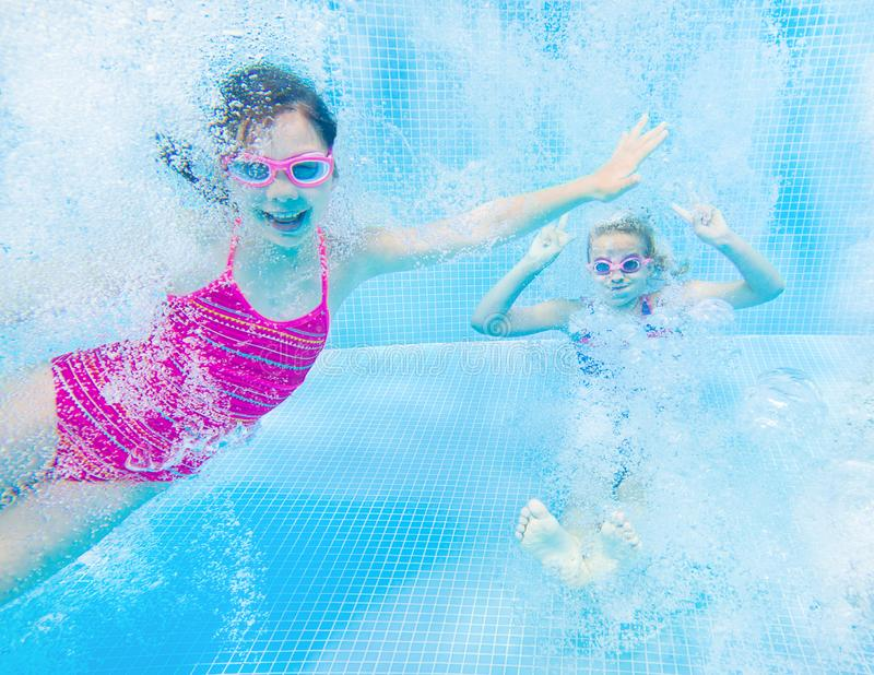 Children swim in  pool royalty free stock images