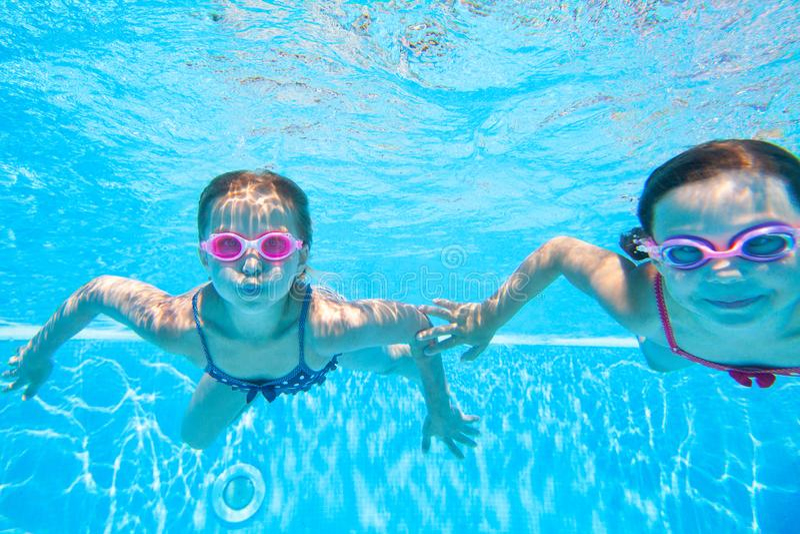 Children swim in  pool stock photos