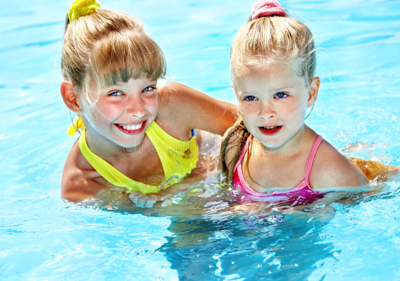 Children in swimming pool. Summer outdoor royalty free stock image