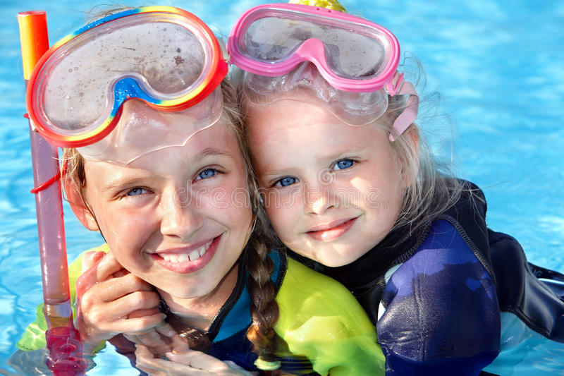 Children in swimming pool learning snorkeling. Sport stock image