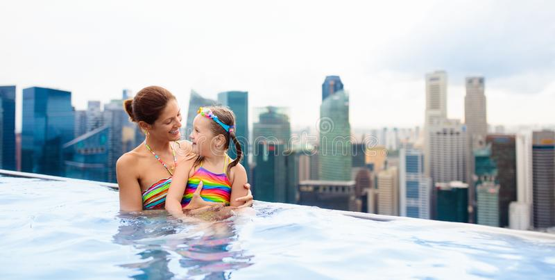 Kids swim in Singapore roof top swimming pool royalty free stock image