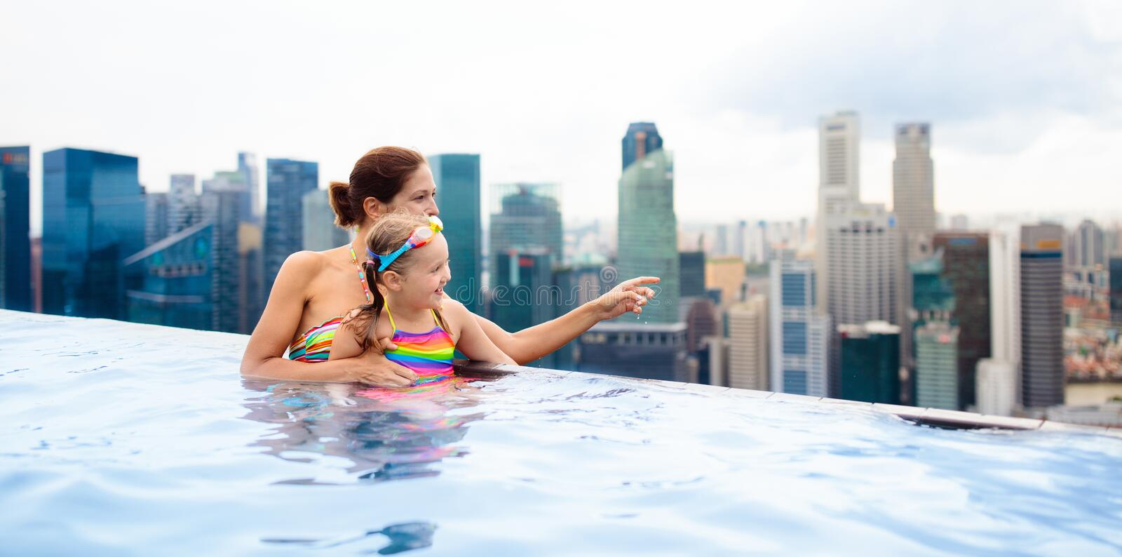 Kids swim in Singapore roof top swimming pool royalty free stock photo