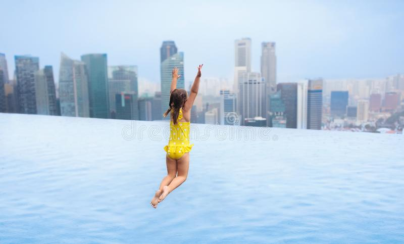 Kids swim in Singapore roof top swimming pool stock photo