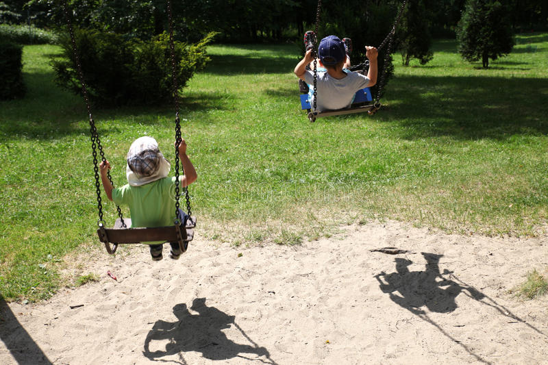 Children on a swing royalty free stock images