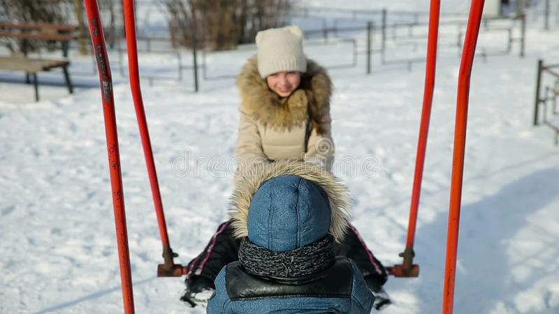Girl ski swinging