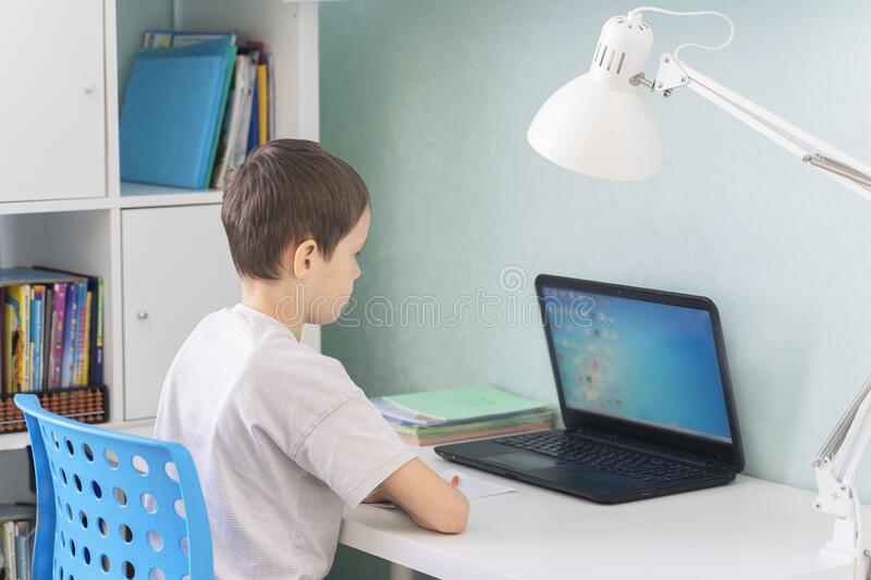 Children switched to distance learning in quarantine. schoolchildren due to the coronavirus pandemic study from home.  stock photo