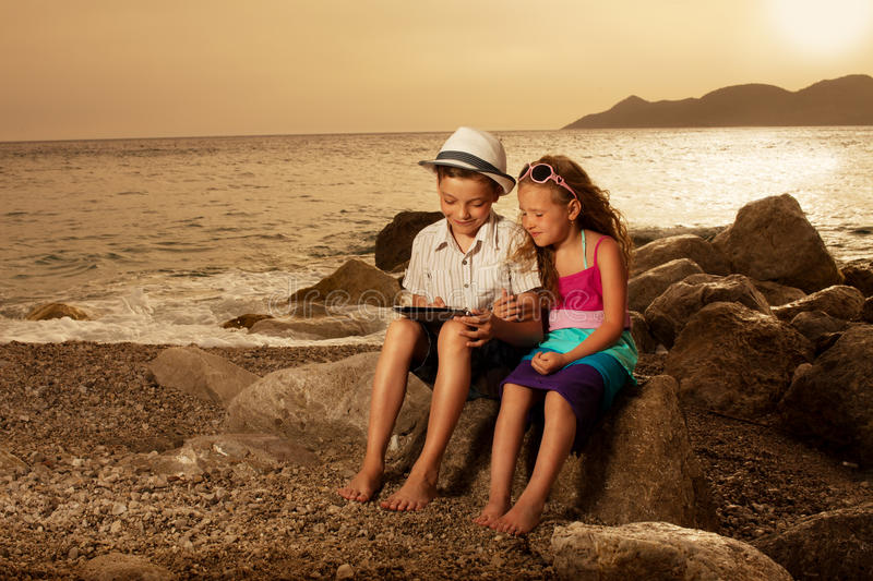 Children with tablet computer stock photos