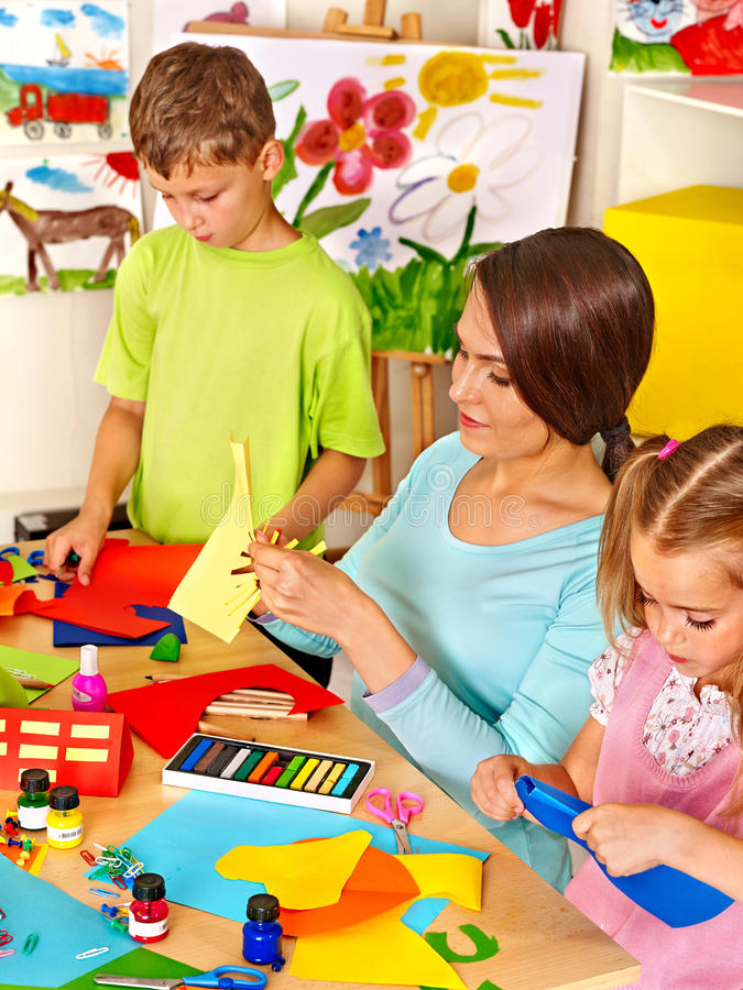 Download Children With Teacher At Classroom. Stock Photo - Image of mother, beautiful: 45148810