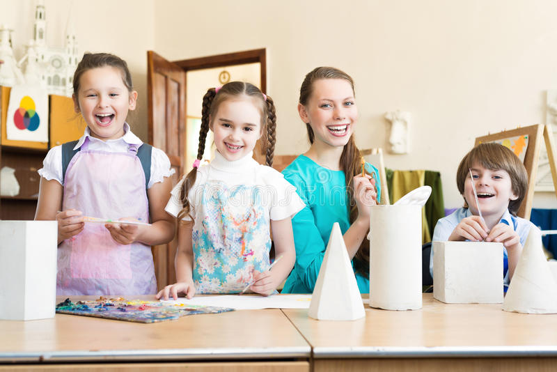 Children with the teacher stock image