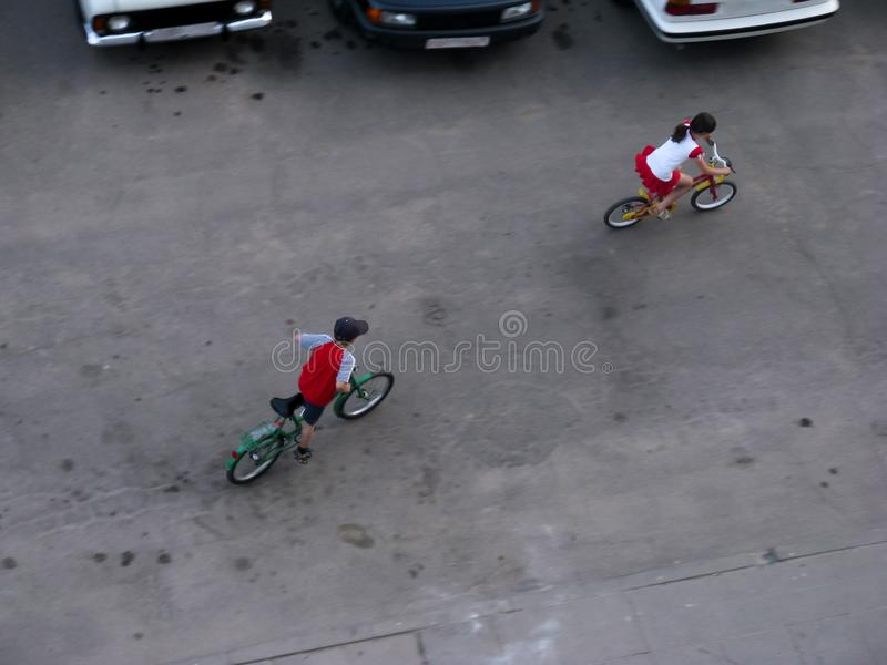 Children teenagers ride bicycles on the roadway stock image