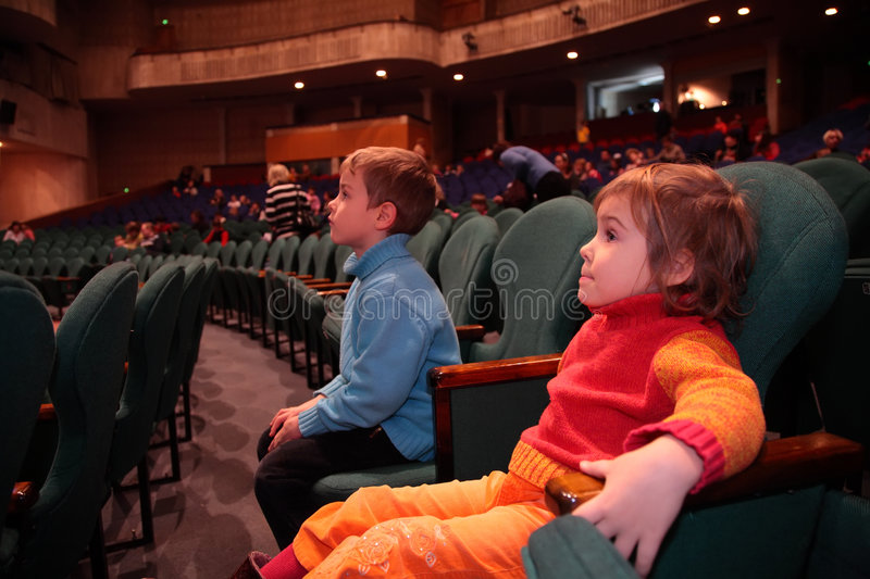 Children in theater stock images