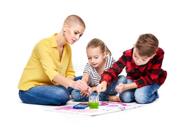 Children with therapist painting with watercolors. Child art therapy, attention and concentration issues, learning difficulties. royalty free stock image
