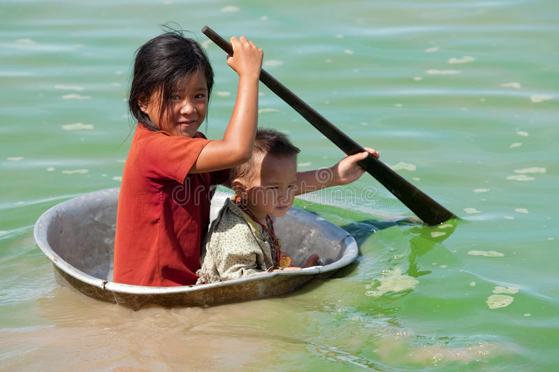 Children in the Tonle Sap lake in Cambodia royalty free stock photos