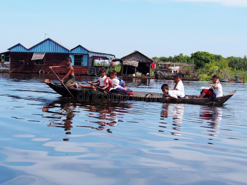Children in the Tonle Sap lake in Cambodia stock photo