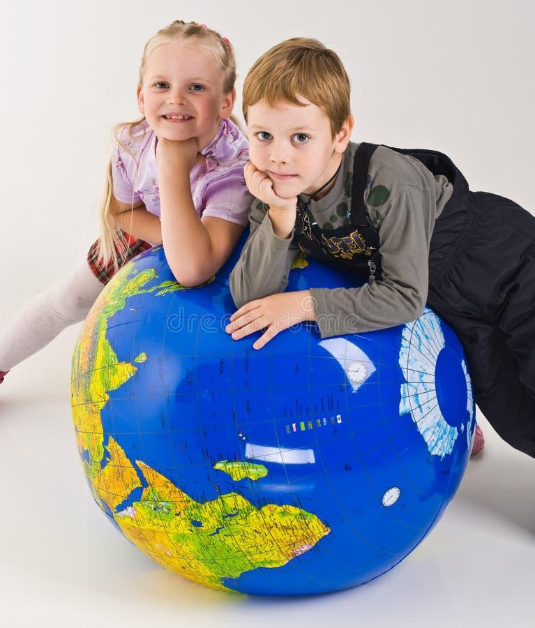 Children On Top Of World Stock Photo