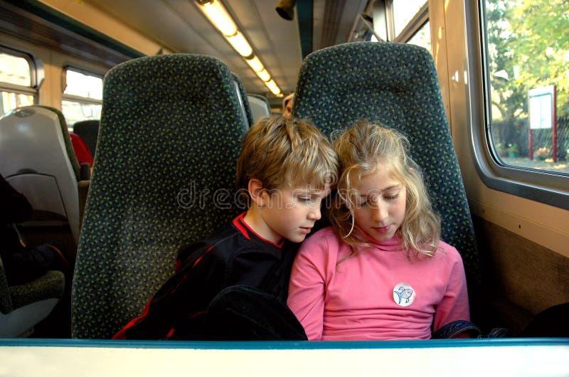 Children on train. Nikon D70, lifestyle portrait of children travelling on train stock photography