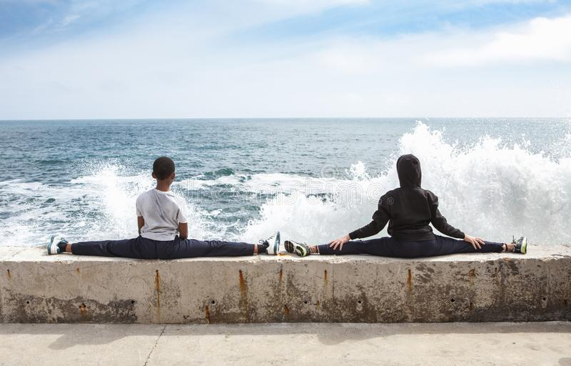Children training karate on the stone coast royalty free stock images