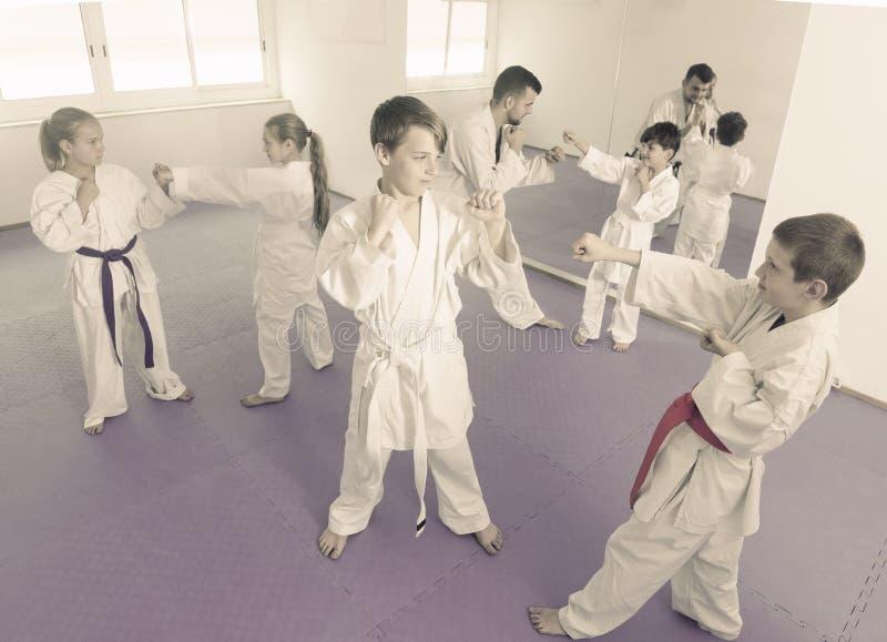 Children training in pairs stock photos