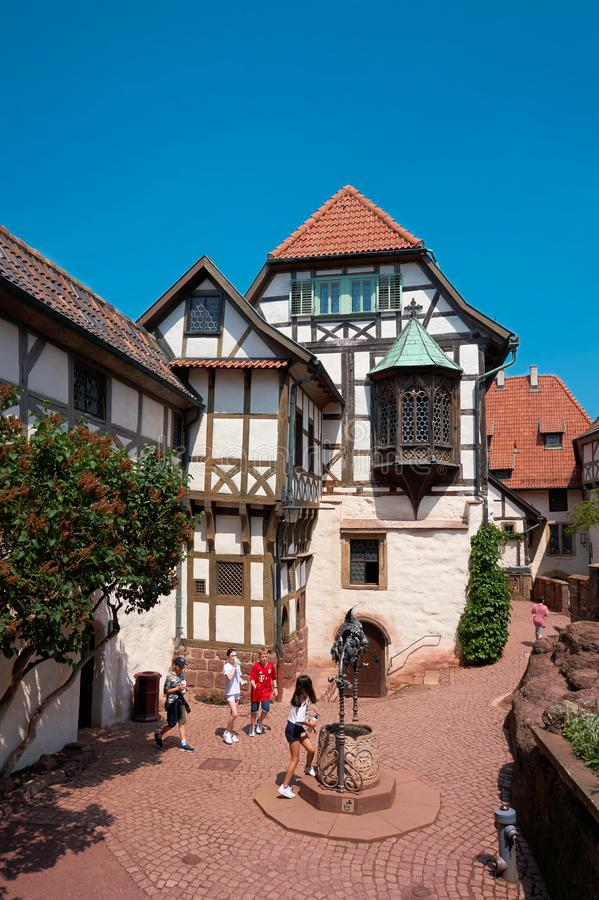 Children of a travel group in the historic courtyard of the Wartburg Castle royalty free stock image