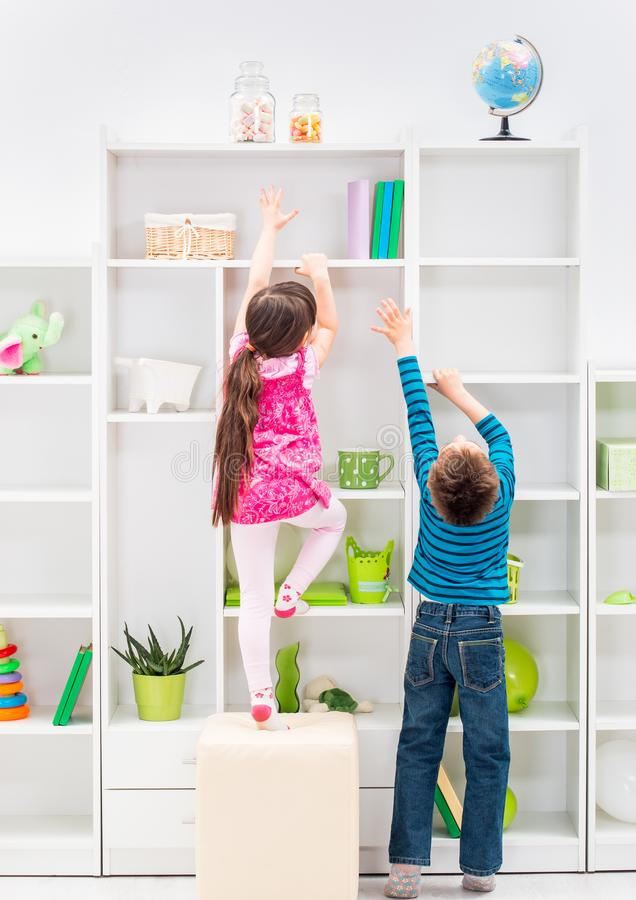 Children trying to reach candy stock photography