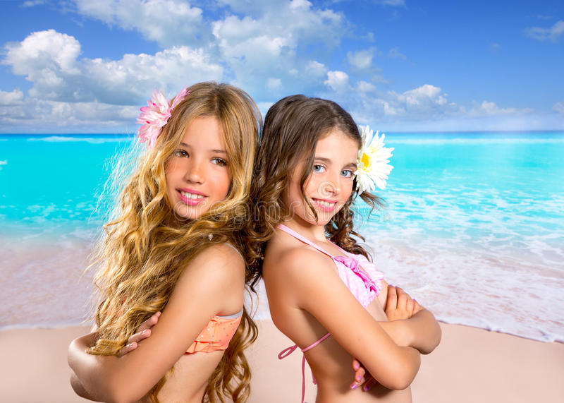 Children two friends girls happy in tropical beach vacation stock photography