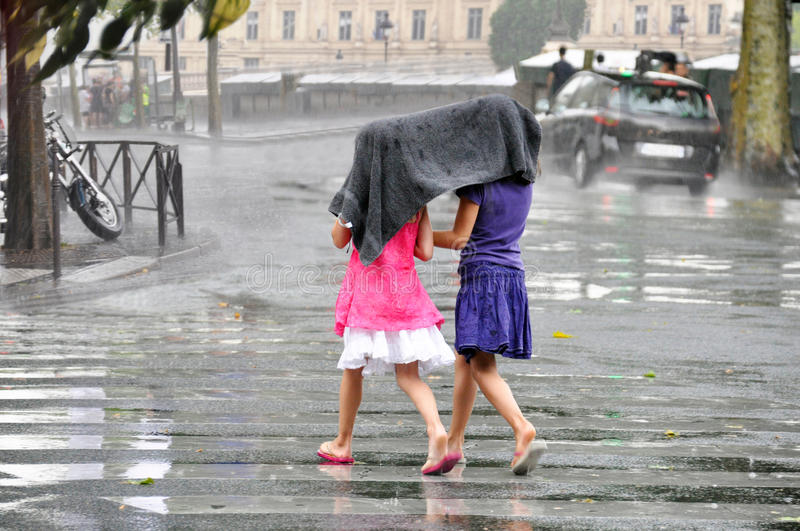 Children under the rain. Two cute little girl under a rain royalty free stock images