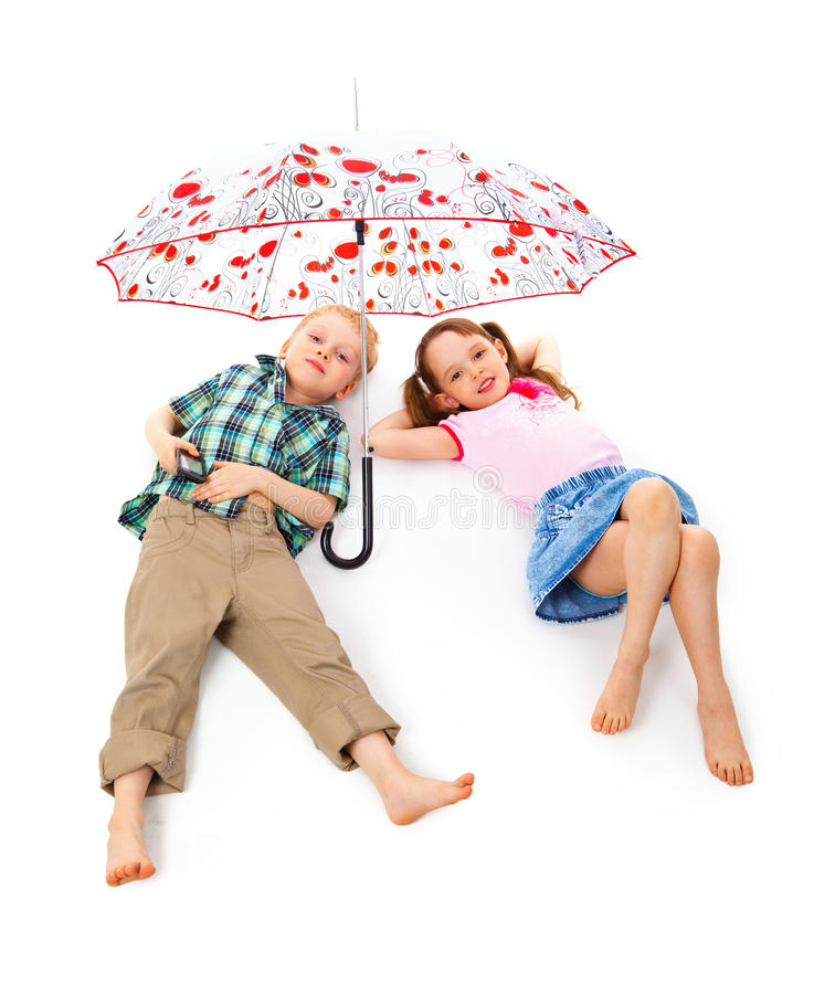 Children under an umbrella royalty free stock photo