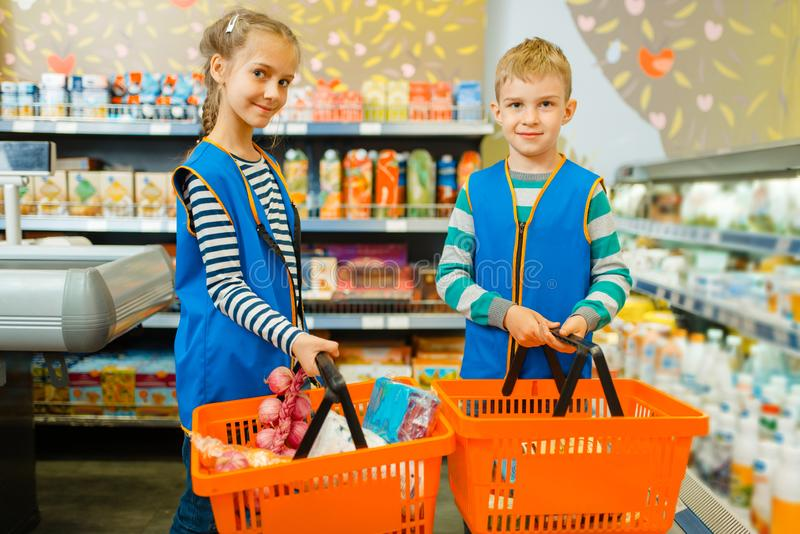 Children in uniform, boy and girl sellers stock photos