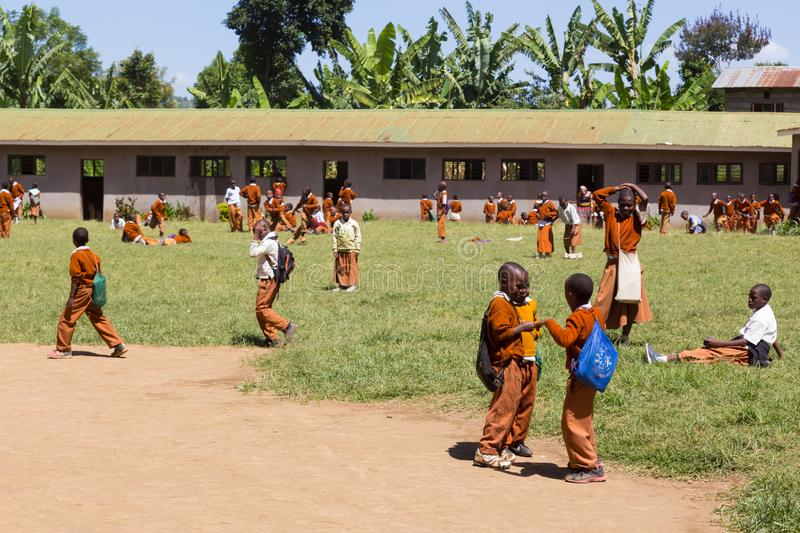 Children in uniforms playing in the cortyard of primary school in rural area near Arusha, Tanzania, Africa. Arusha, Tanzania- Jan 26, 2015: Children in uniforms royalty free stock image