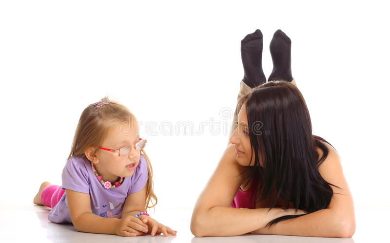 Children upbringing.Mother talking with daughter isolated royalty free stock image
