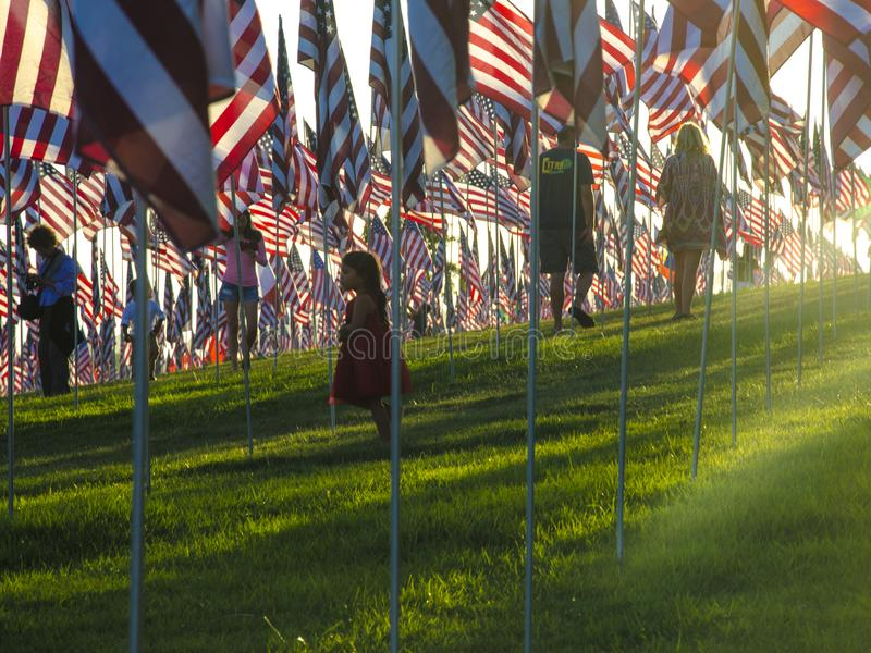 Children and US Flag monument of 11th September in Malibu. Children between Hundreds of United States of America Flags in Malibu, California to honor victims of royalty free stock photo