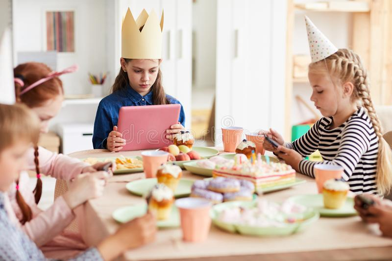 Children Using Gadgets at Party royalty free stock photo