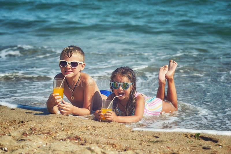 Children on vacation on the beach .Happy children rest in the open air stock image