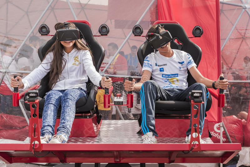 Children with virtual reality headsets. Smiling children playing video games with the help of the virtual reality headsets in a public space on October 4, 2015 royalty free stock photo