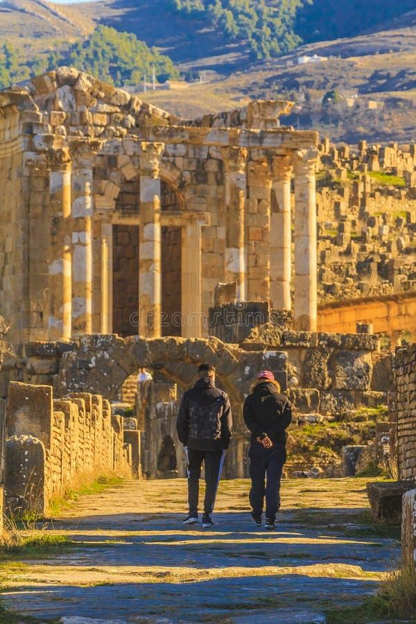 A walk in Djemila. Children visiting the Roman ruin in the Djemila city in Sétif county, Algeria royalty free stock photography