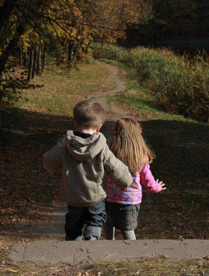 Download Children Walking In The Autumn Park Stock Photo - Image: 13159572